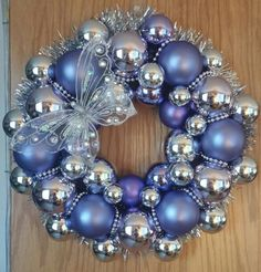 Purple and silver w/butterfly Purple and silver w/butterfly White Christmas Ornaments, Christmas Ornament Wreath, Christmas Door Wreaths, Holiday Wreaths, Blue Christmas, Wreath Crafts, Christmas Crafts, Bauble Wreath, Hanukkah Decorations