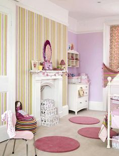 So cute to have a faux fireplace in a little girl's bedroom.  A table for a tea party in front would be perfect!