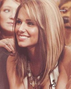 long bob - Medium Length Layered Haircuts.  The side parting with swept-across bangs adds asymmetry to hair graduated in an extreme line ending with shaggy, textured tips at the front.  With brunette balayage in random sections.