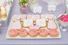 Rosette, crown and dress cookies from an Elegant Purple Princess Birthday Party at Kara's Party Ideas.