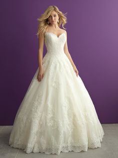This strapless ballgown is adorned with lace appliques and a sweet scalloped neckline // Allure Romance 2959