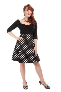 Tammy Polka Dot Swing Skirt The Tammy Polka Dot Swing Skirt is slightly shorter length flared skirt, when compared to Collectif's classic swing styles. Measuring around 24 inches long, the Tammy is perfect for those who prefer a shorter length. Our Dolores doll dress shape is one of our best-selling styles, so it made perfect sense to adapt her into this adorable little number. #Rockabilly #50s #polkadot