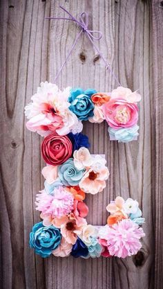 Making our initials with paper flowers/pompoms, seen on Etsy