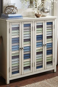 Country cottage meets seaside retreat in the fun and versatile East Bay Cabinet from Pier 1. Mismatched louvre doors with metal ring pulls mimic the look of salvaged architecture. Inside are four roomy adjustable shelves for storing all you need for a day at the beach.