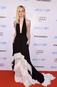 """Elle Fanning wears a plunging black-and-white Emilio Pucci gown at the """"About Ray"""" premiere."""