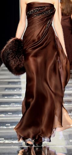 love the chocolate brown with the embellishments.  hope that is faux fur ..not a fan of real fur.