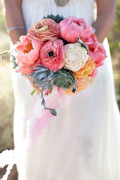 Love. Ranunculus (the ruffled one's in different hues), peonies (coral w/ yellow inside), and green succulants (echiveria). Beautiful color palette!