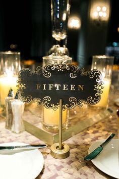 Nancy Aidee Photography; wedding reception table number idea; photo: Nancy Aidee Photography