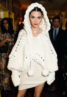 Kendall Jenner wears a Burberry couture cape from today's runway finale, at The LOVE Magazine party in London.