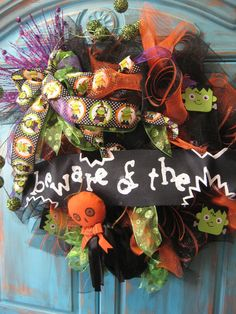 BEWARE OF THE monster large wreath w/ large bow, monsters on lime/ orange/ black on deco mesh wreath- Halloween wreath. $74.99, via Etsy.