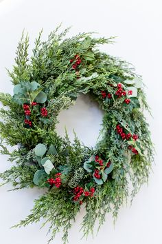 The TomKat Studio 1 Staircase Done 3 Ways-Classic Christmas Wreath