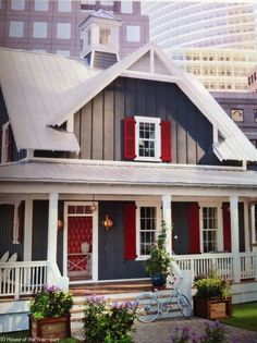 Gray batten board siding, white trim and red shutters