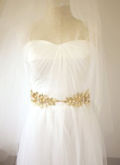Gold Leaf Belt Bridal Belt Gold Bridal Belt Gold by ABitofLoveTB | Ooh, really like this one. Actually, most of the sashes on etsy are under $150. The sash I tried on at BHLDN was $450, maybe they just have fancier crystals.