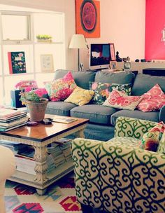 Beautiful colors and prints in this living room.