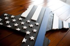 This handcrafted Thin Blue Line Texas wood flag is a symbol used by police and law enforcement to commemorate fallen officers—made in the USA. Custom orders available.