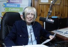 """Pearl Oliva, who hosts """"Guido Oliva Italian Hour,'' sits in her booth at the WSRO Station in Framingham."""