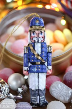 Cross stitched blue nutcracker ornament