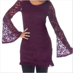 """Purple Crochet Bell Sleeve Tunic NWOT and direct from the distributor. I have these in a size small only. It is form fitting and should be able to fit an extra small, small or a small medium. Measures approx. 16"""" arm pit to arm pit and 31"""" length. Has a scoop neck with a fringe hem (see 3rd) with bell sleeves and an open back design. The inside is lined. The tunic length will look great with leggings or skinny jeans. Shell 67% cotton, 25% nylon, 8% spandex. Lining 100% polyester. Smoke free…"""