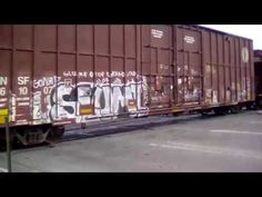 BNSF is carrying a mix freight train on railroad crossing