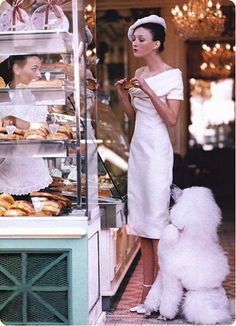 I love everything about this, the chandeliers, the dress, the shoes, the beret, the dog...everything.