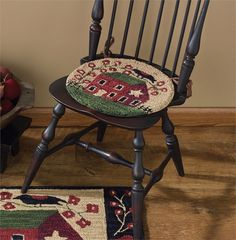 """Designed by artist Teresa Kogut, rich colors are combined with classic motifs to create this stunning design. Handcrafted, hooked polyester yarn. Machine wash cold, lay flat to dry. Dimensions: 14.5""""D"""
