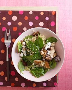 The quinoa adds protein as well as a chewy texture to this meatless main dish. The heat of the cooked quinoa and mushrooms helps wilt the spinach; the dressing and feta pull this warm salad together.