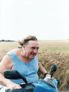 Gérard Depardieu, hair to the wind, flying on his scooter. Jonas Unger photographs the french actor at his château in the Loire Valley @New Yorker