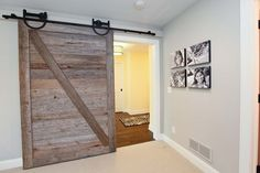 HOME DECOR – SLIDING BARN DOORS – Add history to a new build with sliding barn doors. If you wish you lived in a rambling old farmhouse but must make do with a plain-Jane contemporary home, consider adding a salvaged wood barn door — this one modification can change the look and feel of your entire house.