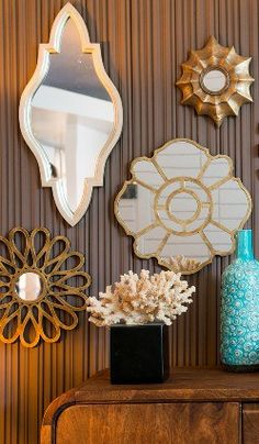 Mismatched mirrors are a great way to accessorize a wall!