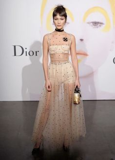 "Bella Hadid was definitely best dressed this week with her runway-to-real life look. She attended Dior Beauty's ""The Art of Color"" in New York City, accessorizing her sheer dress--a look from Maria Grazia Chiuri's first collection for the Parisian house--with a statement choker and a sequined bag."