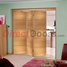 The 3 door Santandor Oak prefinished folding door set can open left or right and towards or away from you.  #nuvufoldingdoors