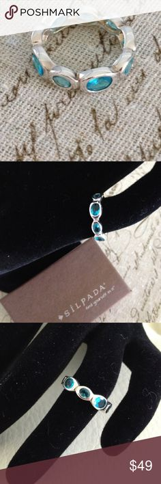 New! .925 Sterling Silver & Glass Ring This new condition .925 Sterling Silver ring is adorned with sparkling aqua glass. Silpada Jewelry Rings