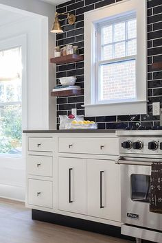 Glossy Black Kitchen Backsplash Tiles That Go All The Way Up To The Ceiling