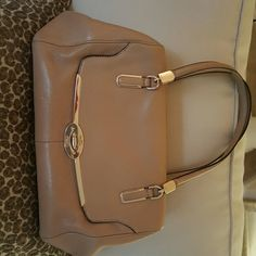 Coach Leather Purse In great used condition. One small pen mark shown in picture and very light scratches on hardware from normal use. Inside has no marks or stains. Great bag with tons of life left! Coach Bags