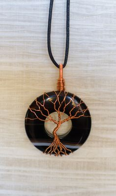Tree of Life wire wrapped Black and brown by RecycledBeautifully