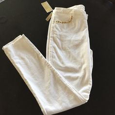 """Michael Kors white skinny stretch jeans Michael Kors white skinny stretch jeans, size 8. Gold studs on front pockets, gold logo button & logo bar on back pocket.  31"""" inseam.  98% cotton, 2% elastane.  A must have staple for summer!  New with tag attached. Michael Kors Jeans Skinny"""