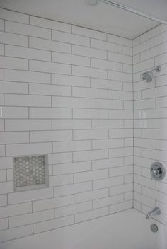 Shower Design: Subway Tile and Marble Tile Niche - THE SWEETEST DIGS - - Choosing our shower tile design with subway tile and marble tile niche. This white and gray bathroom features IKEA vanities and herringbone floor. Upstairs Bathrooms, Basement Bathroom, Small Bathroom, Bathroom Ideas, Master Bathroom, Boy Bathroom, Basement Apartment, Bathroom Makeovers, Bath Ideas