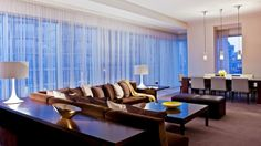 Enjoy luxury suites in Atlanta at the Loews Atlanta Hotel, offering warm and inviting executive and presidential suites. Atlanta Hotels, Great Hotel, Hotel Reservations, Hotel Deals, Photo And Video, Luxury, Table, Furniture, Home Decor