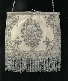Antique white and silver finely beaded purse with sterling silver frame.