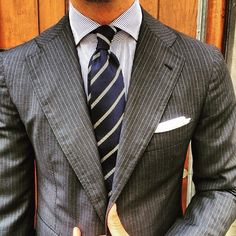 Gentlemen: a beautiful example that you're suit should move with you. Look at the creasing on the shoulder. It's meant to do that