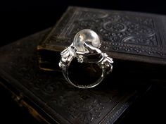 Polished sterling silver Oracle ring with clear natural quartz crystal ball.