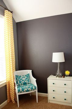 love these gray walls, yellow chevron curtains, and turquoise pillow.  So happy!