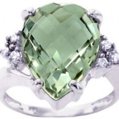 Pear Cut Green Amethyst Diamond Engagement Ring - A prominent bright gemstone will illuminate the love of your life with this Pear Cut Green Amethyst Diamond Engagement Ring set in 14k White Gold that's placed in a 4 Prong setting featuring a Green Amethyst Cut center stone with 6 White Round cut accent side stones. This Pear Green Amethyst engagement ring is an SI1 in color with a G-H in clarity & the total weight is equal to 6.45 carats. The diamonds are 100% natural…