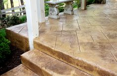 Porch steps are not only functional but can add curb appeal to your porch. Front porch steps, if designed correctly, can make a small porch appear larger or a large porch more grand! Get ideas to maximize the functionality and appeal of your home's steps. Stencil Concrete, Painted Concrete Floors, Stamped Concrete, Wood Tiles, Concrete Color, Front Porch Steps, Small Front Porches, Decks And Porches, Concrete Patio Cost