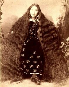 Woman with very long hair, c. 1900s