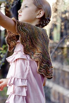 Little House Shawl. Knit from the hem up using very basic lace and shaping. Though designed for child, it will make a shawlette for an adult. Free pattern.
