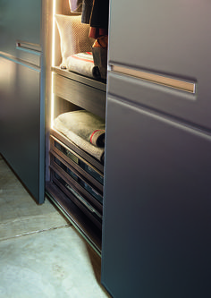 A close up of the warm sliding wardrobe by Lema.