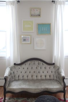 This nursery designed around a vintage settee family heirloom! Love the bright touches to this nursery.