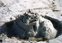 """A sand castle with """"servants' quarters"""" at the base."""