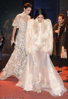 Twinning! The Keeping Up With The Kardashians stars mirrored each other's sexy look as they both stepped out in sheer lace gowns for their big-screen cameo, likely the Met Gala scene